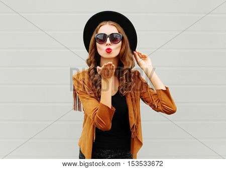 Fashion Portrait Woman Model Blowing Red Lips Sends Air Sweet Kiss Wearing Black Hat, Sunglasses Ove