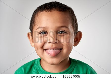 Young boy making silly face portrait in studio