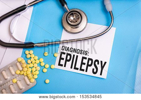 Epilepsy Word Written On Medical Blue Folder With Patient Files