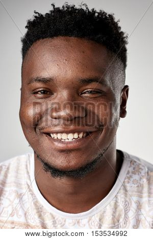 Happy smiling african black man portrait of real person in studio. full collection of diverse faces in this set.