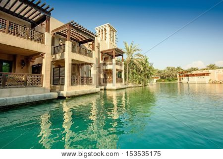 DUBAI, UAE - OCTOBER 06, 2016: Waterfront villas on the Madinat Jumeirah Al Qasr hotel. Madinat Jumeirah houses three iconic hotels in Dubai, also including Mina Salam and Burj al Arab