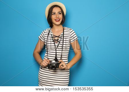 Fashion Young Girl Makes The Photo With Old Camera. Blue Background