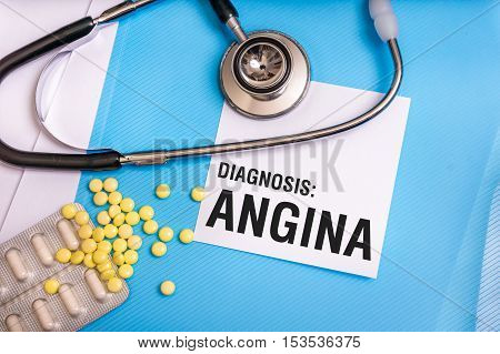 Angina Word Written On Medical Blue Folder With Patient Files