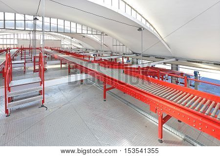 Red Conveyor Belt Distribution and Delivery Warehouse