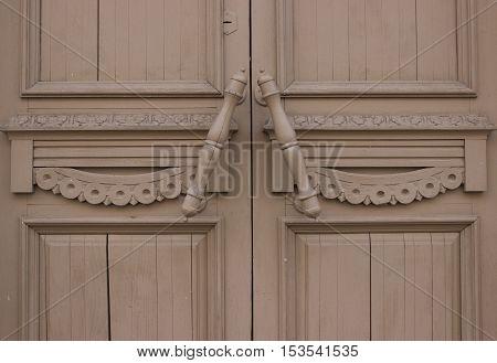 old wooden door with a doorknob close up