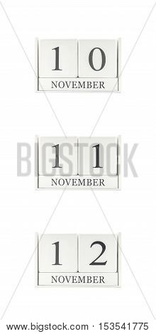 Closeup group of white wooden calendar with black 10 11 12 november word three date calendar isolated on white background