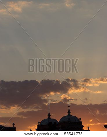 silhouette of a building roof with spire
