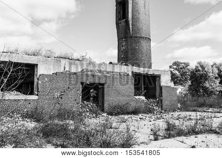 Abandoned Factory with Brick Smokestack and the Remnants of the Power Plant II