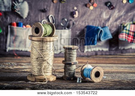 Sewing Mat Made Of Buttons, Needles And Threads In Tailor Workshop