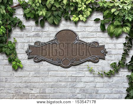 Vintage cast metal plate and climbing plant on the white brick wall