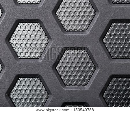 Abstract background of black and silver metal. It looks like a part of the spacecraft
