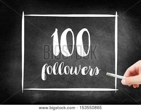 100 followers written on a blackboard