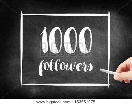 1000 followers written on a blackboard