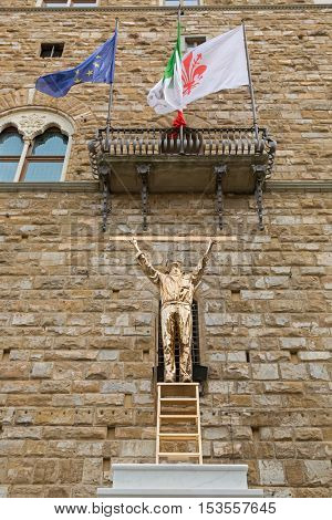 FLORENCE, ITALY - SEPTEMBER 2016 : Bronze sculpture statue of The Man Who Measures the Clouds, standing atop a ladder with ruler in Florence, Italy on September 21, 2016. By Jan Fabre, Belgian artist