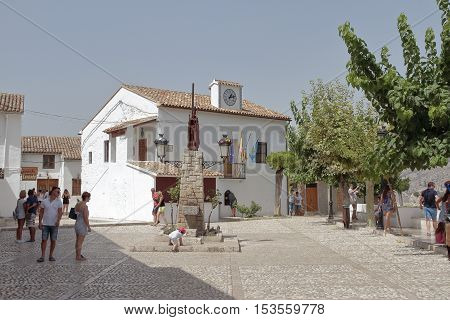 GUADALEST; ALICANTE; SPAIN - AUGUST 28:Tourists visiting the town hall square in El Castell de Guadalest. Picture taken on August 28; 2016 in El castell de guadalest; Alicante; Spain