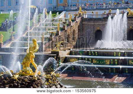 PETERHOF, RUSSIA - MAY 26, 2015: Samson Fountain, the Grand Cascade and Grand Peterhof Palace. Peterhof Palace included in the UNESCO World Heritage List. Petergof, Saint Petersburg, Russia