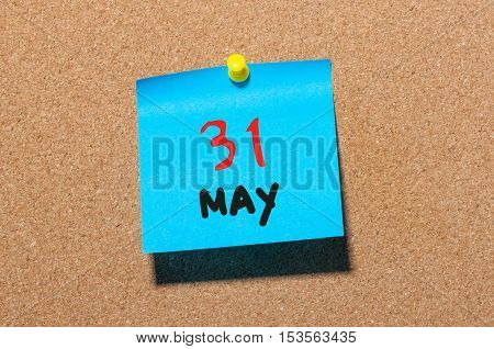 May 31st. Day 31 of month, calendar on cork notice board, business background. Spring time, empty space for text.