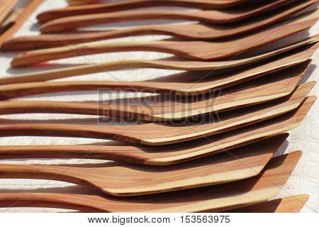 Handmade wooden pan blades at street market.
