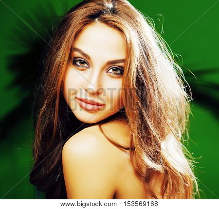 young cute brunette woman on green palm background smiling happy, lifestyle peole concept close up