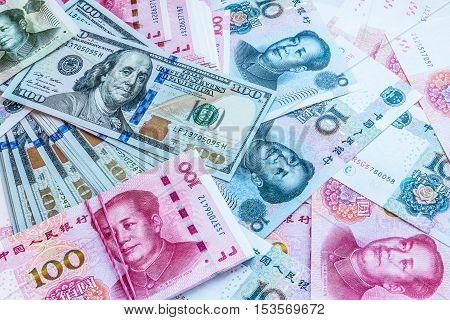 China and USA money bank notes background.