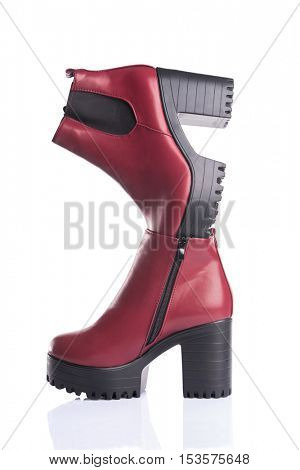 Studio shot of a pair of red autumn boots, isolated on white background