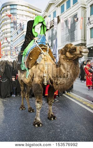 Istanbul Turkey - October 11 2016: Representation on the camels to revive Karbala in the seventh century takes part in an Ashura parade. Turkish Shia Muslims mourning for Imam Hussain. Caferis take part in a mourning procession marking the day of Ashura i