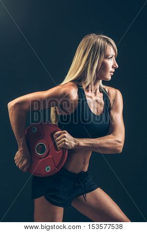 Fitness woman doing a weight training by lifting a heavy weights barbells, sports lifestyle