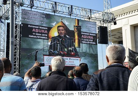 Istanbul Turkey - October 11 2016: ASURE Mourning Ceremony Turkey Jafari Leader Selahattin Ozgunduz making public speeches on the big screen. Caferis take part in a mourning procession marking the day of Ashura in Istanbul's Kucukcekmece district Turkey o
