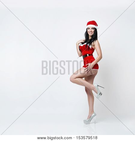 very beautiful and sexy girl dresses as a sexy santa claus