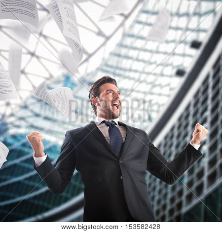In the office businessman exults throwing sheets