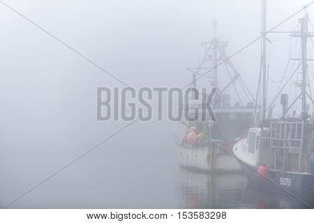 Westport Massachusetts USA - September 2 2014: Fishing boats on foggy morning in Westport Massachusetts