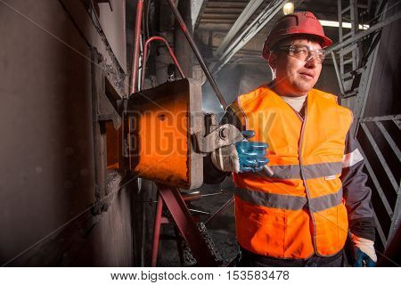 RUSSIA - OCTOBER 19: worker at a factory that heats water