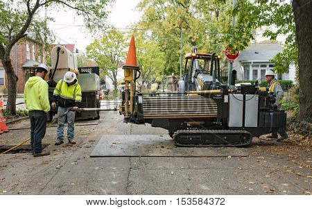 DAYTON, OHIO, USA - OCTOBER 25, 2016: Workers operate horizontal directional drill to replace steel or cast iron pipes with new plastic gas lines in a residential area for Vectren Energy Delivery.