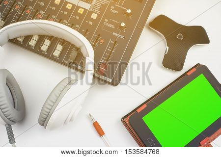 White headphones with audio mixer in Control Room to the recording sessions, workshops, and recreation.