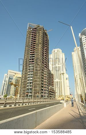 DUBAI, UAE - OCTOBER 07, 2016: Dubai Marina is a man made marina stretching over 3km of land. Unfinished and partly constructed buildings still stand in the Marina