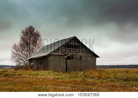 The first snow came in October in the Northern Finland. It soon melted away but left some frost on the fields and on the roof of the old barn house.