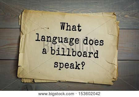 Traditional riddle. What language does a billboard speak?( Sign language.)