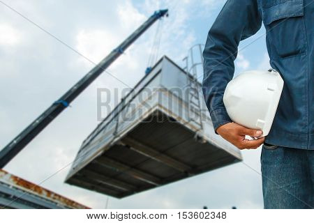The engineering and safety helmets stood on the details of Industrial Crane operating and lifting