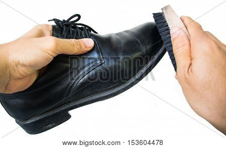 Hand With Brush Cleaning Black Leather Shoe
