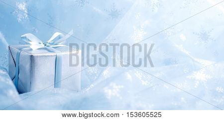 Gift box on abstract background.