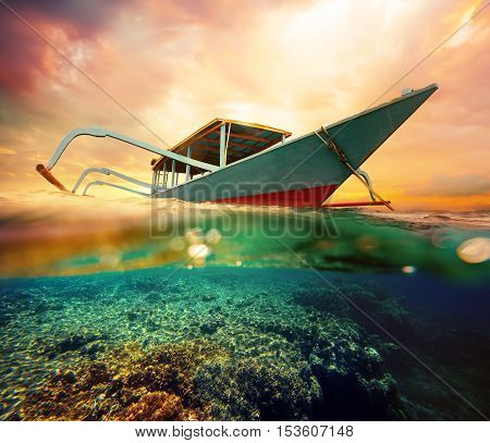 Diving boat at sunset. Underwater shot .