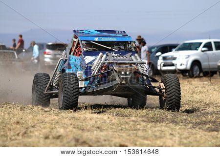 Speeding Blue Bat Spec 0 Rally Car Front View