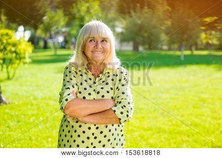 Woman with gray hair smiling. Thoughftul look of senior lady. I have a cunning plan. Reason and logic.