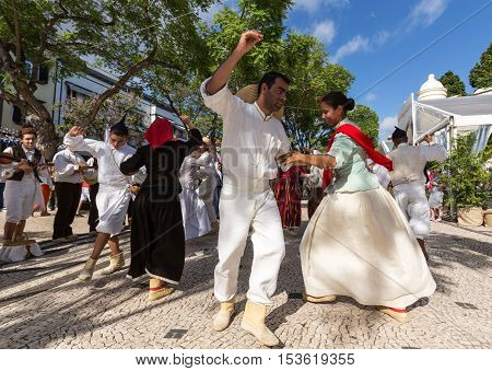 FUNCHAL PORTUGAL - SEPTEMBER 1 2015: Dancers with local costumes demonstrating a folk dance during the Wine Festival in Funchal on the Madeira Portugal.