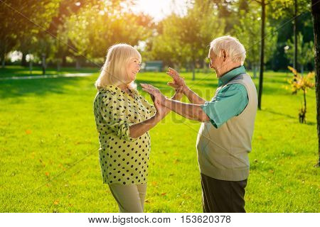 Senior woman and man outdoor. Two people touching hands. You were right. No sense to argue.