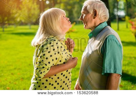 Angry woman with man. Two senior people outdoors. Don't make me mad. Aggression won't solve the problem.