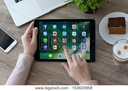 Alushta Russia - October 9 2016: A set of programs from famous brands of social networking on the iPad Pro in woman hands. iPad Pro 9.7 was created and developed by the Apple inc.
