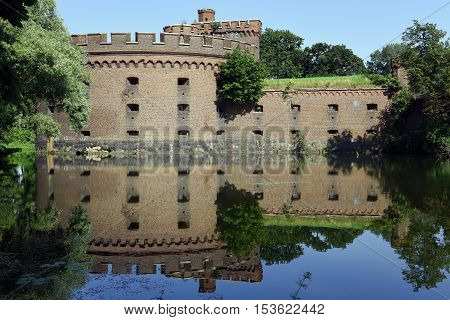 The Wrangel tower, Kaliningrad, reflected in the water like a mirror