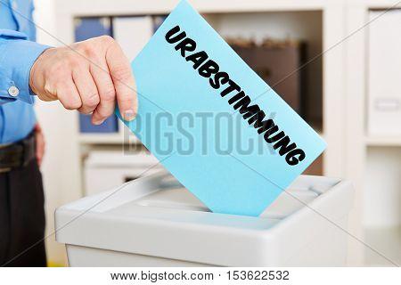 Hand with ballot with German word Urabstimmung (strike vote )