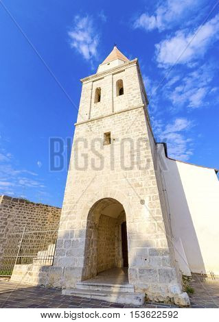 The pyramidal tower of the Church of our Lady of Health a romanesque cathedral formely named St Michael the archangel basilica at the Square of the The Glagolitic housed monasteries on Krk island in Croatia.